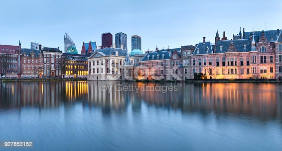 City Landscape, sunset panorama - view on pond Hofvijver and complex of buildings Binnenhof in from the city centre of The Hague, The Netherlands
