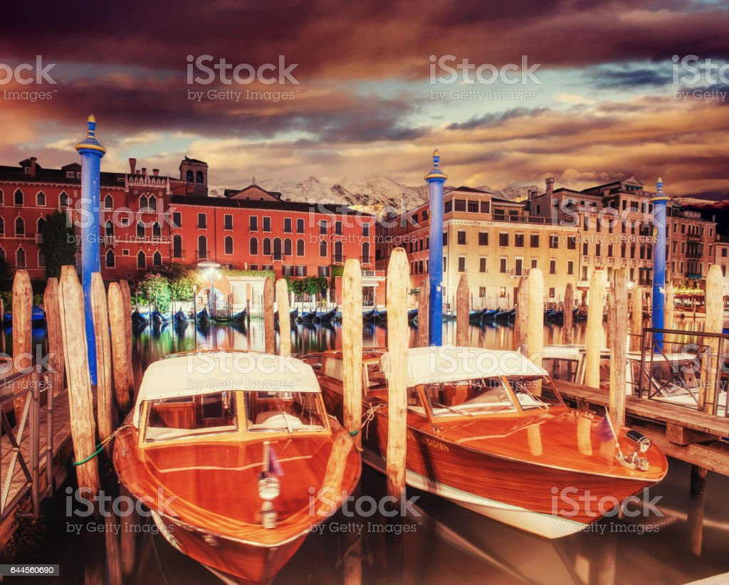 City landscape. Venice at sunset. Green water with boats stock photo