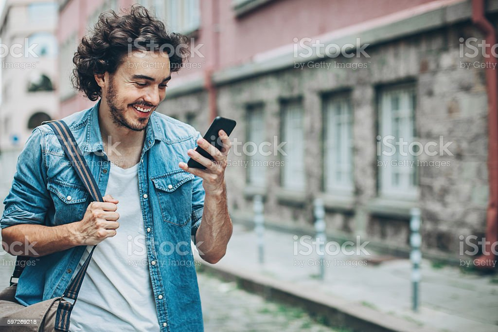 City life and text messaging royalty-free stock photo