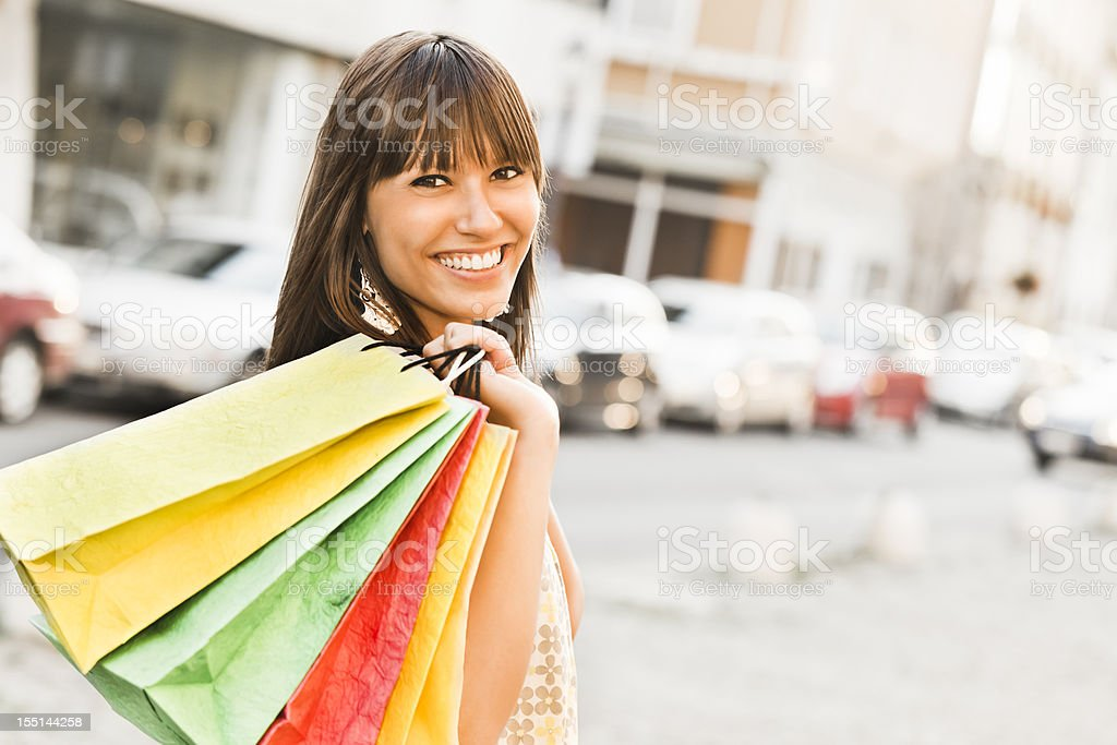 City life series: happy woman holding shopping bags royalty-free stock photo