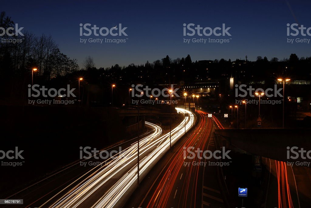 city life with autobahn and moon over horizon royalty-free stock photo