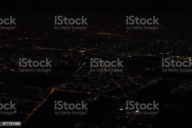 Photo of City lights at night from plane.