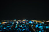 Blurred abstract background bokeh lights with city road view