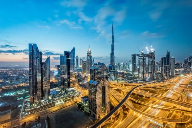 City lights in Dubai; United Arab Emirates Dubai, Burj Khalifa, United Arab Emirates, Sunset, Cityscape dubai stock pictures, royalty-free photos & images