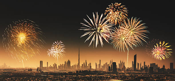 city lights of dubai downtown with fireworks - uae national day 뉴스 사진 이미지
