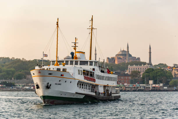 city lines ferry and hagia sophia with old town in istanbul istanbul,Turkey-may 3,2017.city lines ferry and hagia sophia with old town in istanbul bosphorus stock pictures, royalty-free photos & images