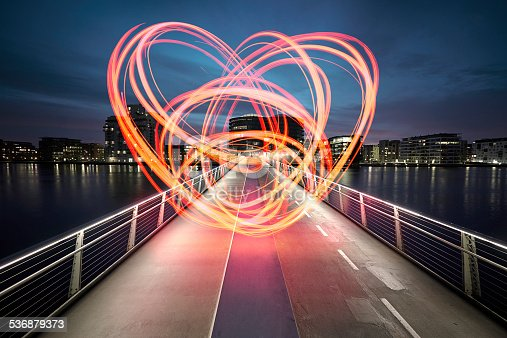 Large heart drawn with light on a bridge connecting the two sides of the harbor. Love for the city we live in. Love sign
