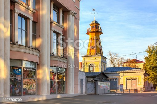 Kurgan, Russia - October 5, 2018: City Mall and Fire Observation Lookout Tower in the centre of Kurgan, Russia.