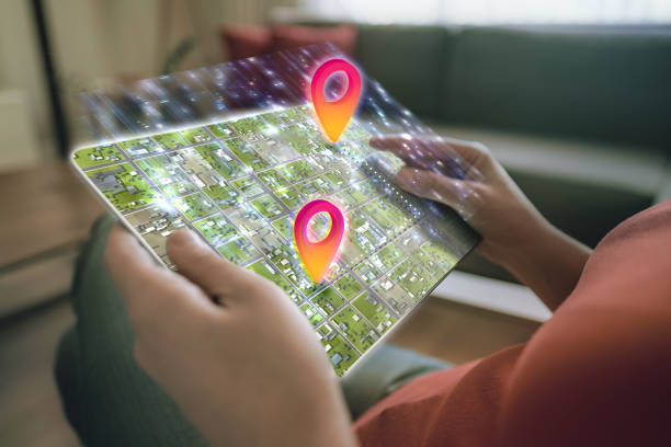 city map on a digital tablet screen - изыскание стоковые фото и изображения