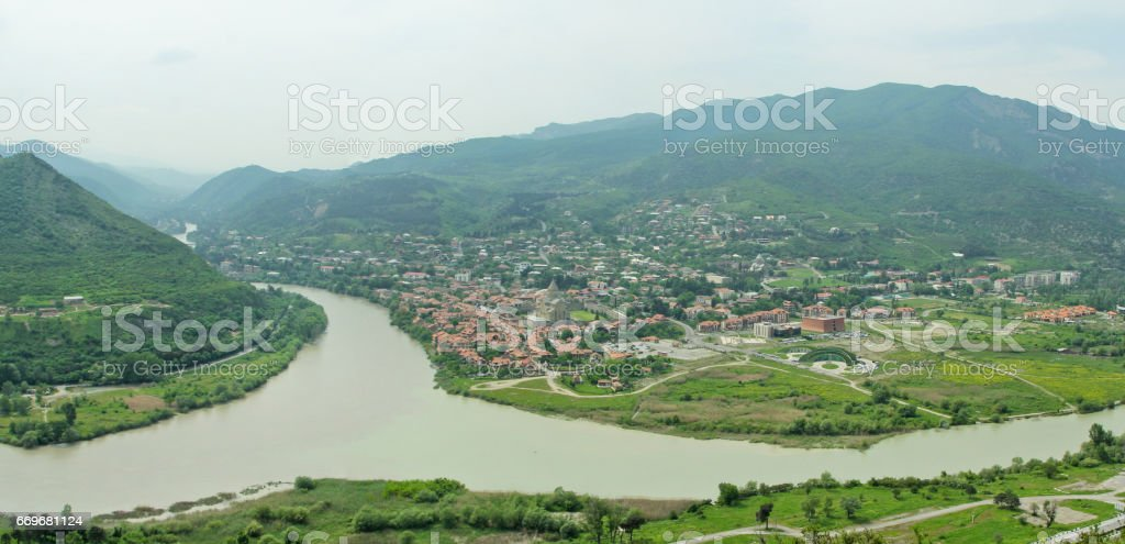 City Mtskheta in Georgia, rivers Aragvi and Kura, and stunning mountains at the background. stock photo