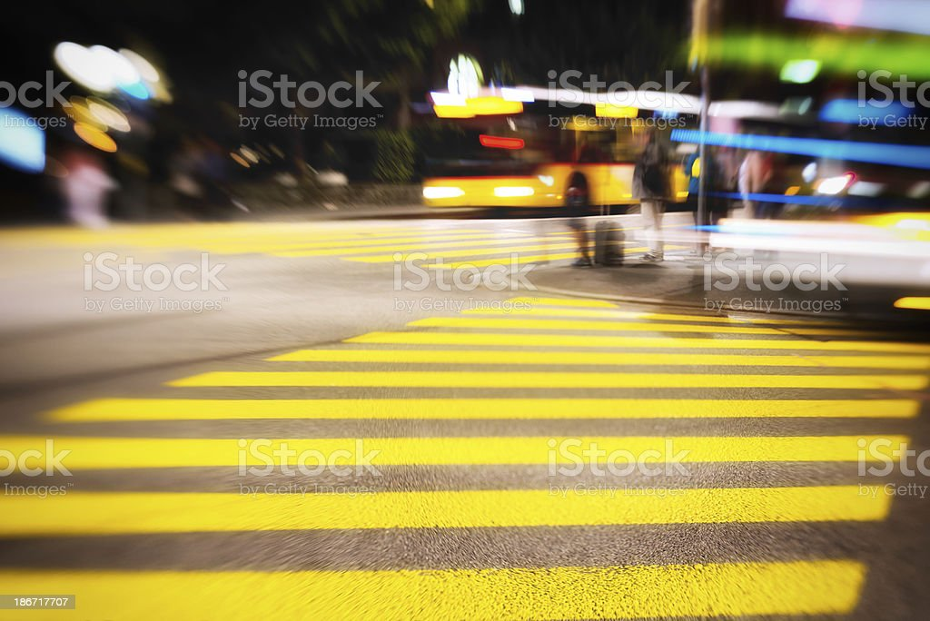 city night scene with people and crosswalk in switzerland royalty-free stock photo