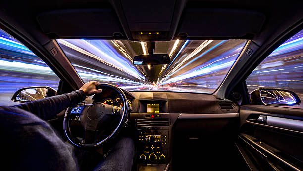 city night velocity motion car inside urban barcelona long exposure - car interior stock photos and pictures