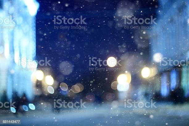 Photo of city night winter snow blurred background