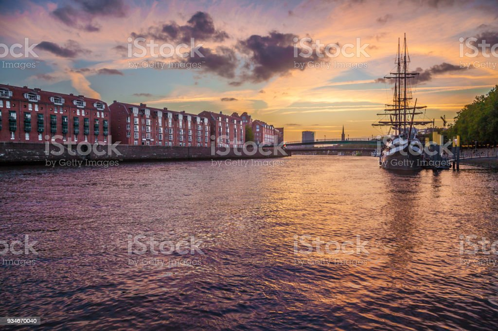 City of Bremen with old sailing ship on Weser river at sunset, Germany stock photo