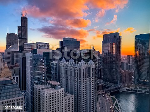 483312814 istock photo City of Chicago at sunset in downtown Loop along the Chicago River and Wacker Drive 1072320880