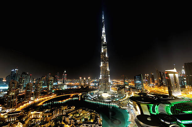 city of dubai at night stunning ariel view of the main dubai city around the famous burj kalifa tower in full at night. The entire place is glittering with lights and expansion of estate is on going. burj khalifa stock pictures, royalty-free photos & images