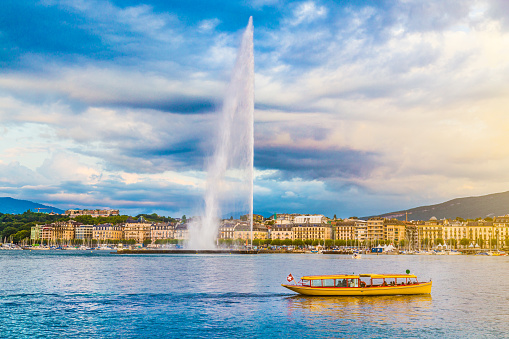 City Of Geneva With Jet Deau Fountain At Sunset Switzerland Stock Photo - Download Image Now