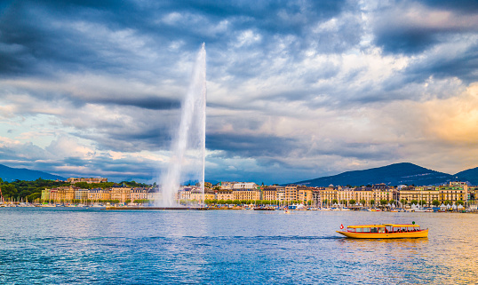 City of Geneva with Jet d'Eau fountain at sunset, Switzerland