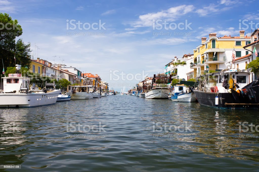 City of Grado channel and boats view stock photo