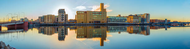 city of green bay skyline reflected in still waters. - green bay wisconsin stock photos and pictures