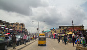 Lagos, Nigeria - May 11, 2012: People and cars in the street, in the city of Lagos, the largest city in Nigeria and the African continent. Lagos is one of the fastest growing cities in the world