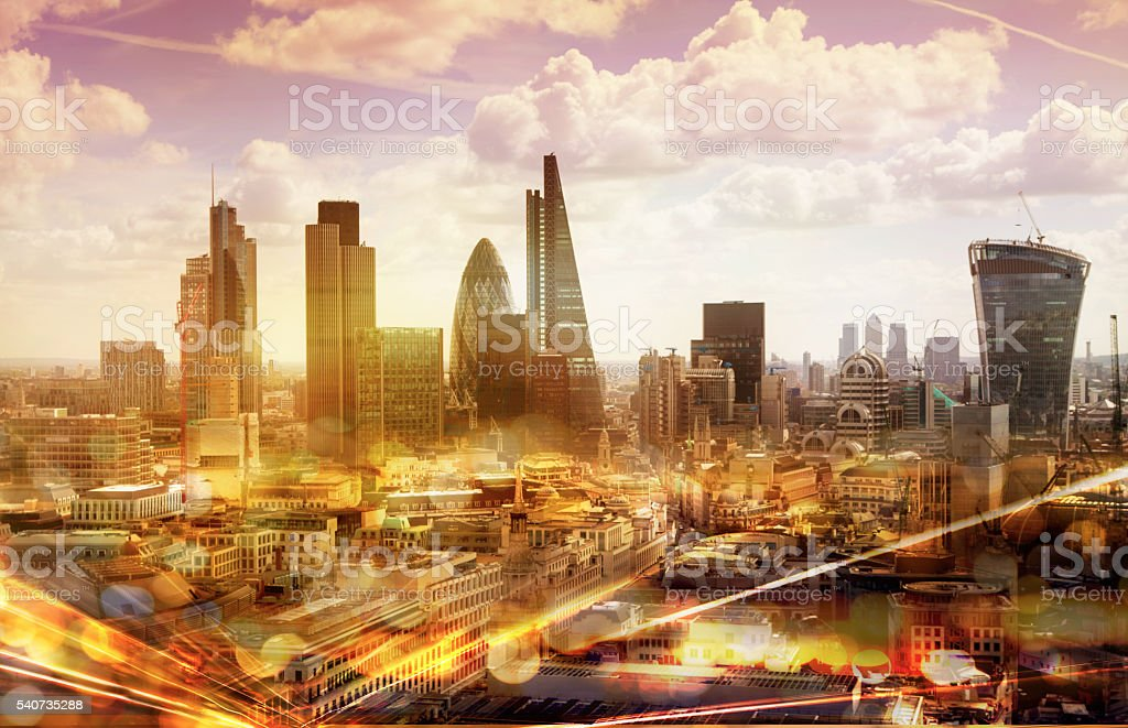 City of London at sunset and traffic lights reflection, London stock photo