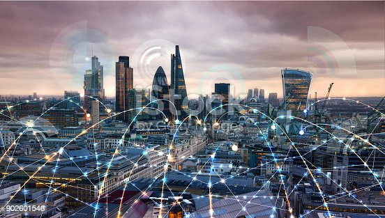 istock City of London at sunset. Illustration with communication and business icons, network connections concept. 902601546