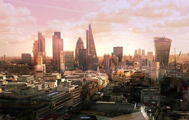 city of london business and banking aria at sunset - london england stock photos and pictures