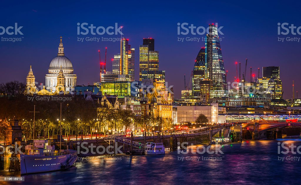 City of London glittering skyscrapers and St Pauls illuminated night stock photo