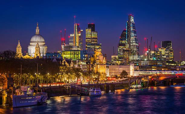 City of London glittering skyscrapers and St Pauls illuminated night stock photo