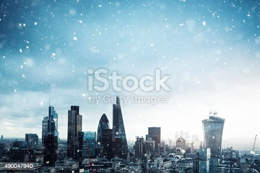 City of London in winter time. Snowflakes falling from the sky.