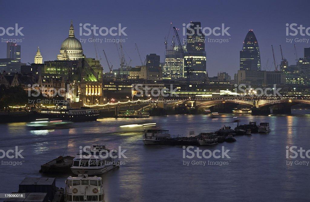 City of London landmarks illuminated River Thames dusk royalty-free stock photo