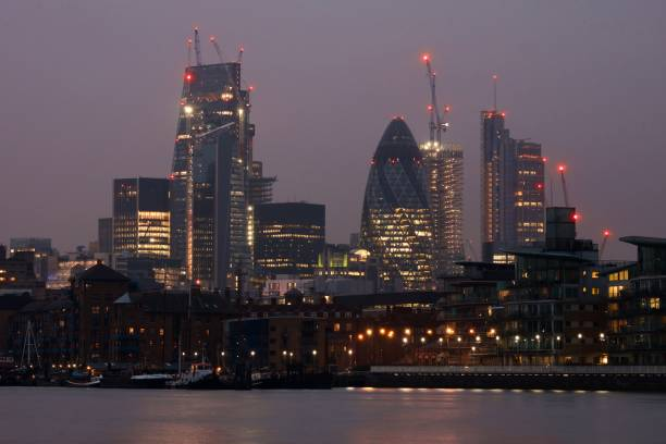 City of London skyline at night Looking towards the City of London from the Thames in late evening. With the Gherkin (30 St Mary Axe) visible. skeable stock pictures, royalty-free photos & images
