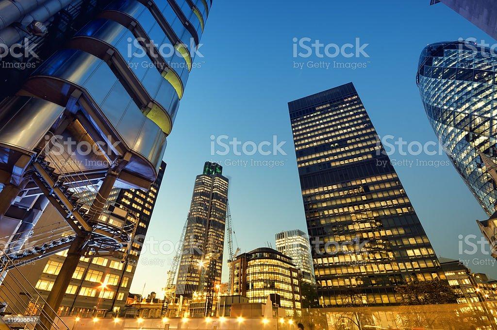 City of London skyscrapers illuminated at night stock photo