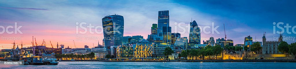 City of London skyscrapers illuminated at sunset overlooking Thames panorama stock photo