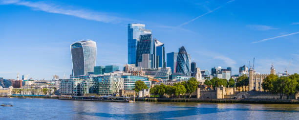 City of London skyscrapers overlooking Thames Embankment at Tower panorama stock photo