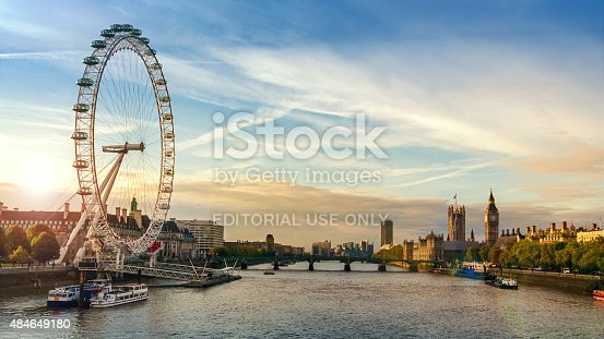 London, England - October 22, 2010: Morning image of London. Includes the London eye, County Hall, Westminster Bridge, Big Ben and Houses of Parliament.