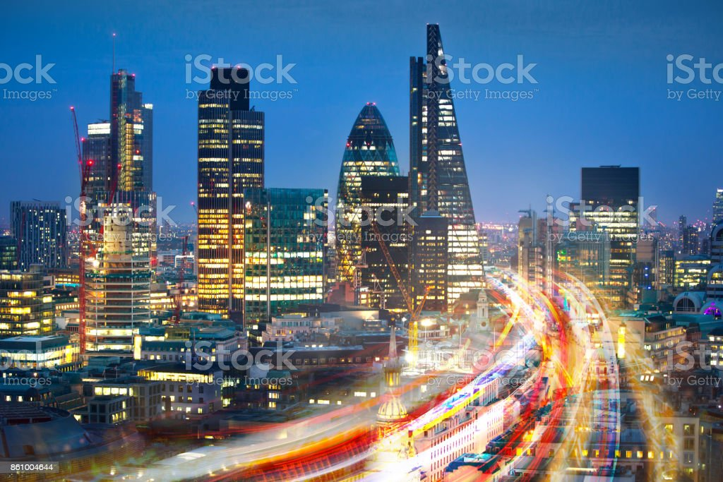 City of London view at sunset and busy road with transport blurred lights. Success, transformation and innovation idea. stock photo
