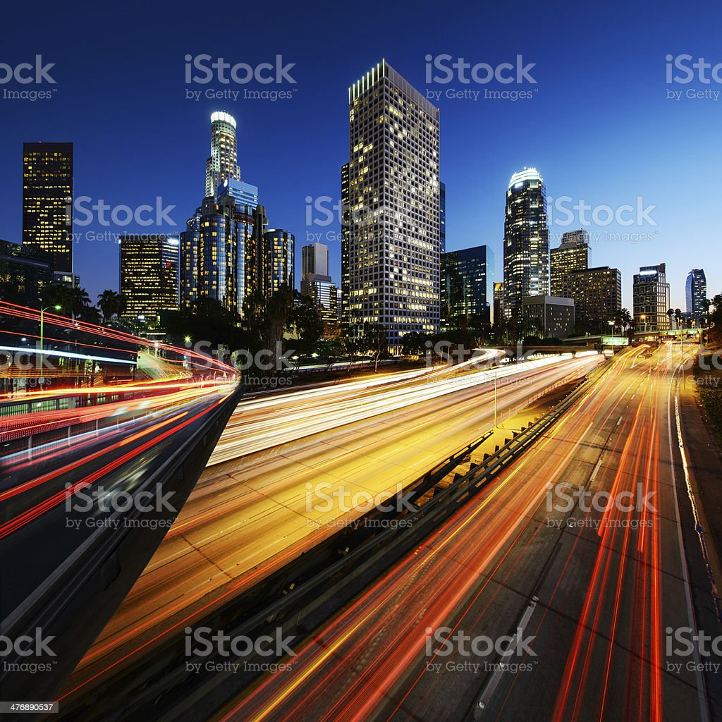 City of Los Angeles California at sunset with light trails stock photo