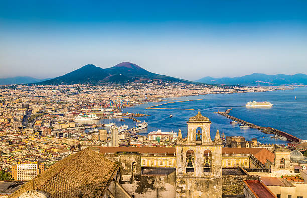City of Naples with Mt. Vesuvius at sunset, Campania, Italy Scenic picture-postcard view of the city of Napoli (Naples) with famous Mount Vesuvius in the background in golden evening light at sunset, Campania, Italy. bay of water stock pictures, royalty-free photos & images