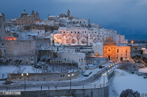 Ostuni, Puglia Italy - Friday January 4, 2019:  Snow-covered historic center. The white city of Puglia is known for its spring and summer belaza. Snow in the city of ostuni is almost a rarity, making it a whiter city with a fantastic look.