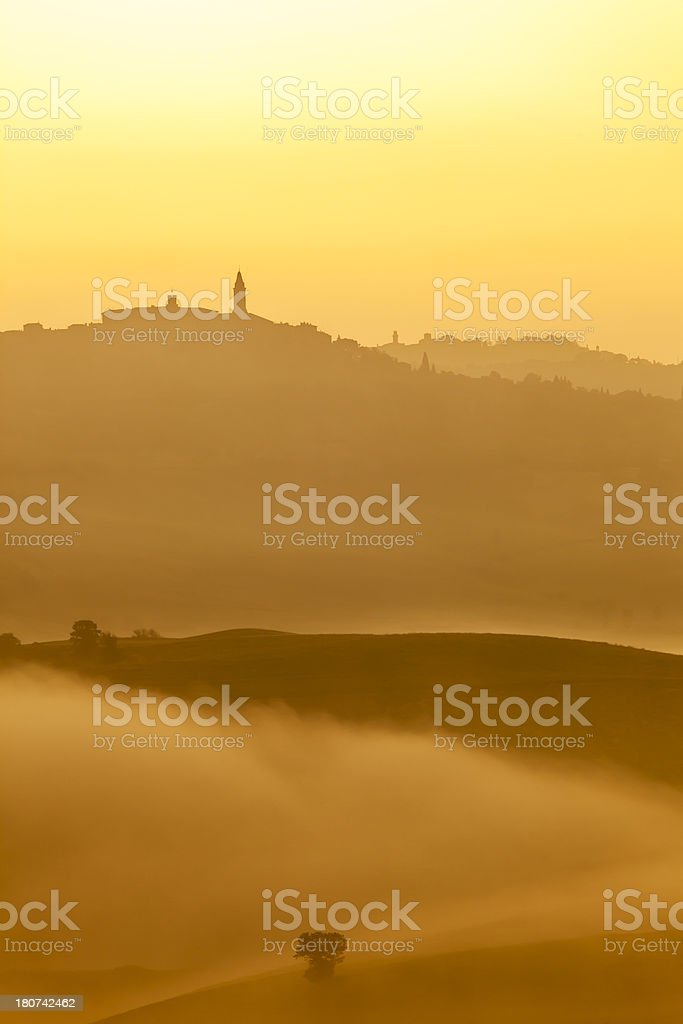 City of Pienza, Tuscan Landscape, Sunrise, Morning Fog, Tuscany, Italy stock photo