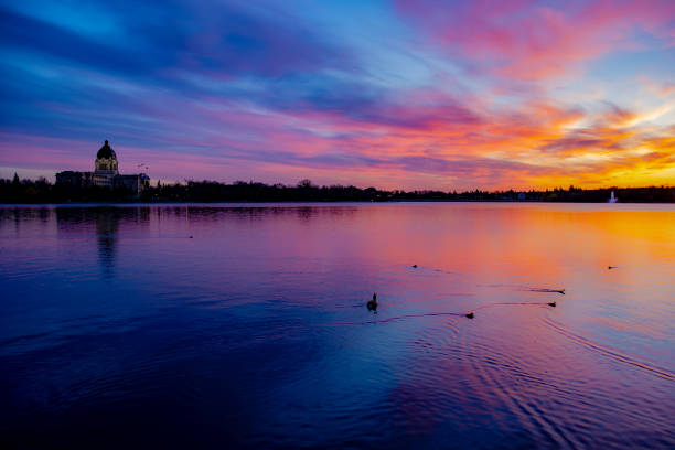City of Regina Skyline in Spring A beautiful sunset over Wascana Lake in Regina Saskatchewan. reflection lake stock pictures, royalty-free photos & images
