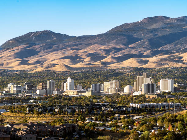 City of Reno Nevada cityscape in early autumn with hotels, casinos, apartments and mountains in the background. City of Reno Nevada cityscape in early autumn with hotels, casinos, apartments and mountains in the background. nevada stock pictures, royalty-free photos & images