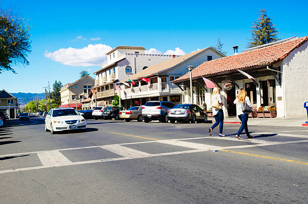 City of Sonoma, California Sonoma, California, United States - October 19, 2015: Shoppers on a pedestrian crossing on East Spain Street in the city of Sonoma, California, on a sunny autumn day. Sonoma is the wine hub for Sonoma Valley, running parallel to, and in rivalry with, its more famous neighbour, Napa Valley. sonoma stock pictures, royalty-free photos & images