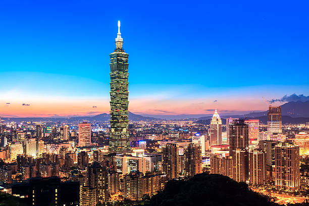 City of Taipei skyline at night View of Taipei World Trade Center and Taipei 101 in Xinyi Business District at dusk. The middle of building ranked worlds tallest from 2004 until 2010. taiwan stock pictures, royalty-free photos & images