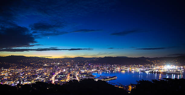 City of Wellington Lit Up at Twilight Still from Getty time lapse video #625850288. View of Wellington from Mount Victoria at dusk. Some sunlight remains in the sky, and the city itself is brightly lit. mt victoria canadian rockies stock pictures, royalty-free photos & images