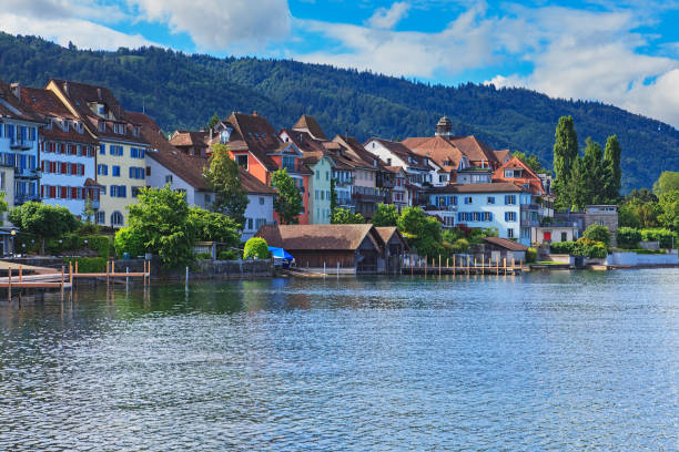 City of Zug in Switzerland on a cloudy day City of Zug in Switzerland on a cloudy day in summer, view from Lake Zug. zug stock pictures, royalty-free photos & images