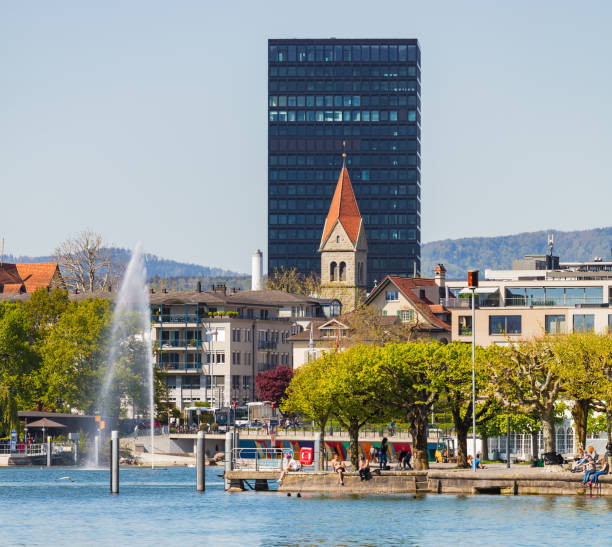 City of Zug in Switzerland Zug, Switzerland - 6 May, 2016: the city of Zug as seen from Lake Zug. The city of Zug is the capital of the Swiss canton of Zug, Lake Zug is a lake in central Switzerland, situated between Lake Lucerne and Lake Zurich. zug stock pictures, royalty-free photos & images