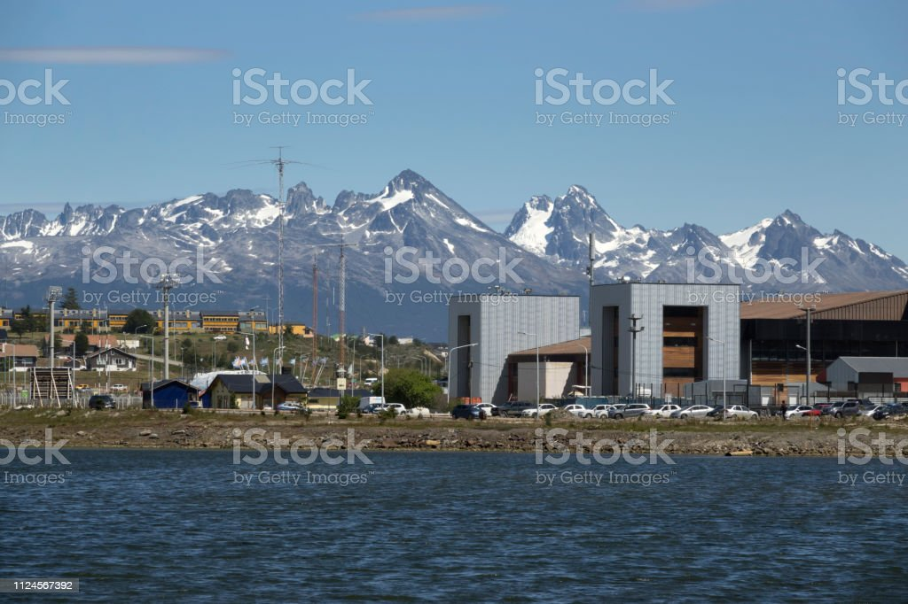 City office buildings apartments Ushuaia Argentina Montes Sampaio mountains Chile stock photo